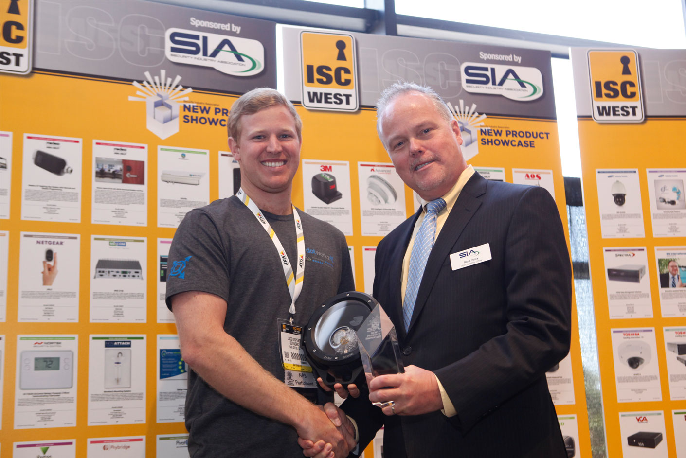 dotworkz 2015 bash wins new product showcase jace dispenza accepting award from sia ceo don erickson